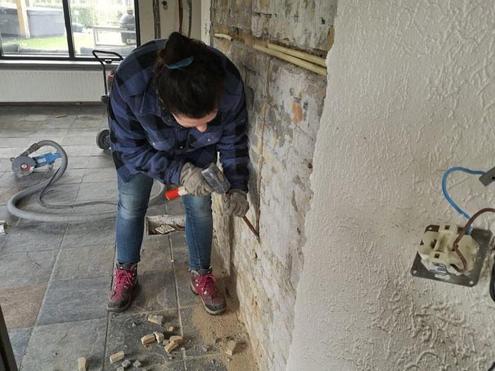 slopen met hamer en beitel